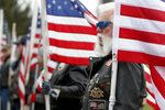 Ken Thompson stands with the other Patriot Guard Riders lined up outside the memorial service for U.S. Air Force Staff Sgt. Dylan J. Elchin on Thursday, Dec. 6, 2018, in Moon Township, Pa. Elchin was one of three servicemen killed last month when their vehicle was destroyed by an improvised explosive device in Andar, in Afghanistan's Ghazni Province. (AP Photo/Keith Srakocic)