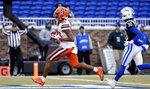Syracuse's Trishton Jackson (86) scores a touchdown ahead of Duke's Jalen Alexander (30) during the first half of an NCAA college football game in Durham, N.C., Saturday, Nov. 16, 2019. (AP Photo/Ben McKeown)