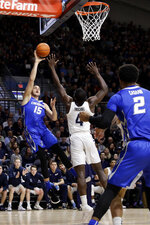 Creighton's Martin Krampelj (15) shoots as Villanova's Eric Paschall (4) defends during the first half of an NCAA college basketball game, Wednesday, Feb. 6, 2019, in Villanova, Pa. (AP Photo/Matt Slocum)