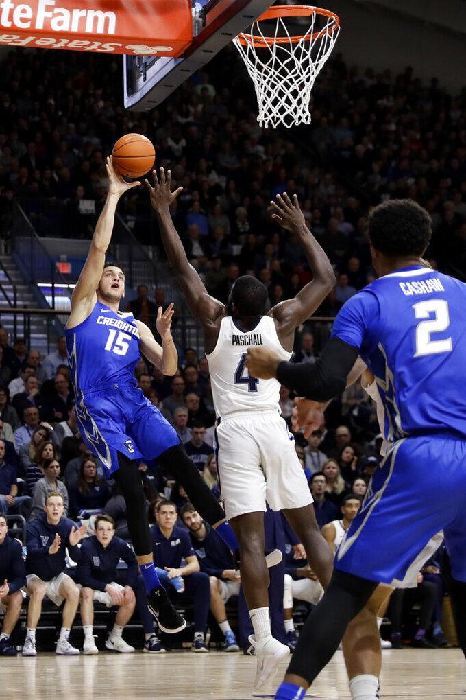 Creighton's Martin Krampelj (15) shoots as Villanova's Eric Paschall (4) defends during the first half of an NCAA college basketball game, Wednesday, Feb. 6, 2019, in Villanova, Pa. (AP Photo/Matt Slocum)