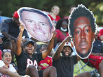 Atlanta Falcons fans cheer for Matt Ryan and Calvin Ridley from the hill overlooking the practice fields during the fourth day of NFL football training camp practice on Sunday, Aug. 1, 2021, in Flowery Branch, Ga. (Curtis Compton/Atlanta Journal-Constitution via AP)