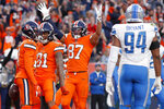 Denver Broncos wide receiver DaeSean Hamilton, left, celebrates his touchdown against the Detroit Lions with wide receiver Tim Patrick (81) and tight end Noah Fant (87) during the second half of an NFL football game, Sunday, Dec. 22, 2019, in Denver. (AP Photo/David Zalubowski)