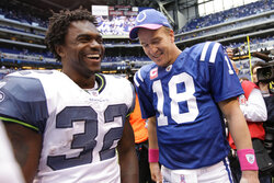 FILE - Seattle Seahawks running back Edgerrin James, left, and Indianapolis Colts quarterback Peyton Manning talk after an NFL football game in Indianapolis, in this Sunday, Oct. 4, 2009, file photo. Edgerrin James took pride in exceeding his standards — and ignoring everyone else's. It made him a perfect complementary piece to Peyton Manning and Marvin Harrison in Indianapolis. The man drafted ahead of Heisman Trophy winner Ricky Williams and as the hand-picked replacement for Marshall Faulk in 1999, carved out his own Hall of Fame career with a gritty work ethic, freewheeling personality, and a commitment to staying true to his roots.(AP Photo/AJ Mast, File)