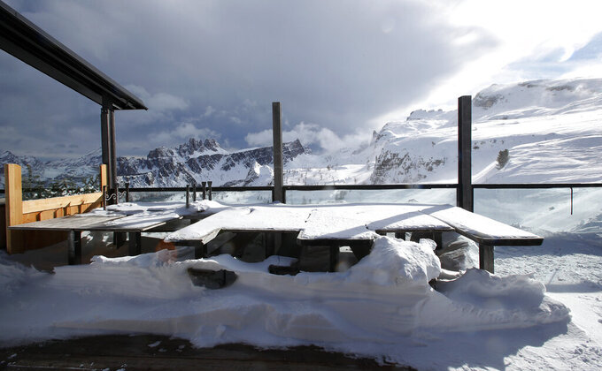 """FILE - In this Friday, Jan. 29, 2021 file photo, a view of the closed hut """"Rifugio Scoiattoli"""" in Cortina D'Ampezzo, Italy. The natural beauty of Cortina will be of special importance at the alpine ski World championships, with organizers hoping that the images from the slopes beamed around the globe to TV viewers will make up for the lack of fans amid the coronavirus pandemic. (AP Photo/Antonio Calanni, File)"""