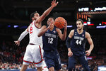 St. John's guard Julian Champagnie (2) defends Georgetown guard Terrell Allen (12) with Georgetown center Omer Yurtseven (44) looking on during the first half of an NCAA basketball game, Sunday, Feb. 2, 2020, in New York. (AP Photo/Kathy Willens)