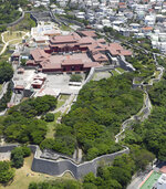 This May 2017, aerial photo shows Shuri Castle in Naha, Okinawa, southern Japan. A fire spread among structures at Shuri Castle on Thursday, Oct. 31, 2019, on Japan's southern island of Okinawa, nearly destroying the UNESCO World Heritage site. (Kyodo News via AP)