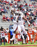 Auburn receiver Jay Jay Wilson (42) and Sam Sherrod (32) celebrate after a touchdown against Arkansas during the second half of an NCAA college football game, Saturday, Oct. 19, 2019 in Fayetteville, Ark. (AP Photo/Michael Woods)