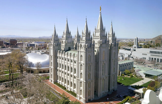 FILE - In this April 18, 2019, file photo, the Salt Lake Temple in Salt Lake City is viewed. The Church of Jesus Christ of Latter-day Saints has asked all its members in Utah to wear face coverings when in public, a request that comes as confirmed coronavirus infections in the state increase. (AP Photo/Rick Bowmer, File)