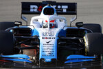 Williams driver George Russell of Britain steers his car during a Formula One pre-season testing session at the Barcelona Catalunya racetrack in Montmelo, outside Barcelona, Spain, Thursday, Feb.21, 2019. (AP Photo/Joan Monfort)