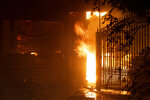 Flames shoot out from the front of a house on Jolette Way in Granada Hills North, Calif., early Friday morning, Oct. 11, 2019. (David Crane/The Orange County Register via AP)