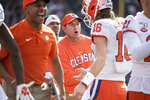 Clemson head coach Dabo Swinney greets Trevor Lawrence (16) after a touchdown against South Carolina during the first half of an NCAA college football game Saturday, Nov. 30, 2019, in Columbia, S.C. (AP Photo/Sean Rayford)