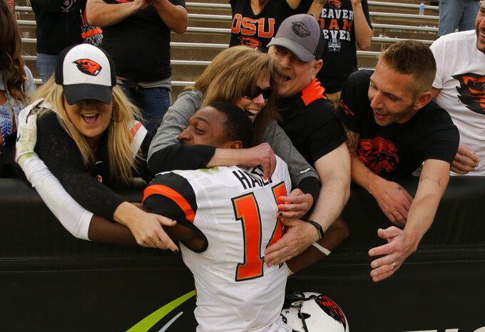 Oregon State cornerback Kaleb Hayes is congratulated by fans after the team's overtime win against Colorado in an NCAA football game, Saturday, Oct. 27, 2018, in Boulder, Colo. (AP Photo/Jack Dempsey)