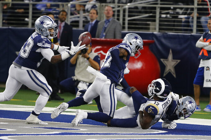 Dallas Cowboys linebacker Justin March-Lillard (53) intercepts a pass intended for Los Angeles Rams wide receiver Brandin Cooks (12) after Cowboys' cornerback Byron Jones, right, and Donovan Wilson (37) broke up the pass on a two-point conversion in the second half an NFL football game in Arlington, Texas, Sunday, Dec. 15, 2019. (AP Photo/Michael Ainsworth)