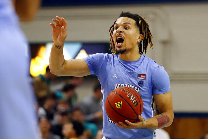 North Carolina's Cole Anthony (2) calls a play against UNC Wilmington during the first half of an NCAA college basketball game in Wilmington, N.C., Friday, Nov. 8, 2019. (AP Photo/Karl B DeBlaker)