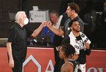 San Antonio Spurs head coach Gregg Popovich, left, and Sacramento Kings head coach Luke Walton greet each other after an NBA basketball game Friday, July 31, 2020, in Lake Buena Vista, Fla. (Kim Klement/Pool Photo via AP)
