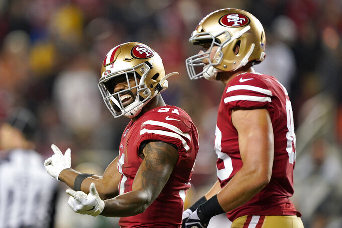 San Francisco 49ers running back Raheem Mostert (31) celebrates next to Garrett Celek after scoring against the Green Bay Packers during the second half of an NFL football game in Santa Clara, Calif., Sunday, Nov. 24, 2019. (AP Photo/Tony Avelar)