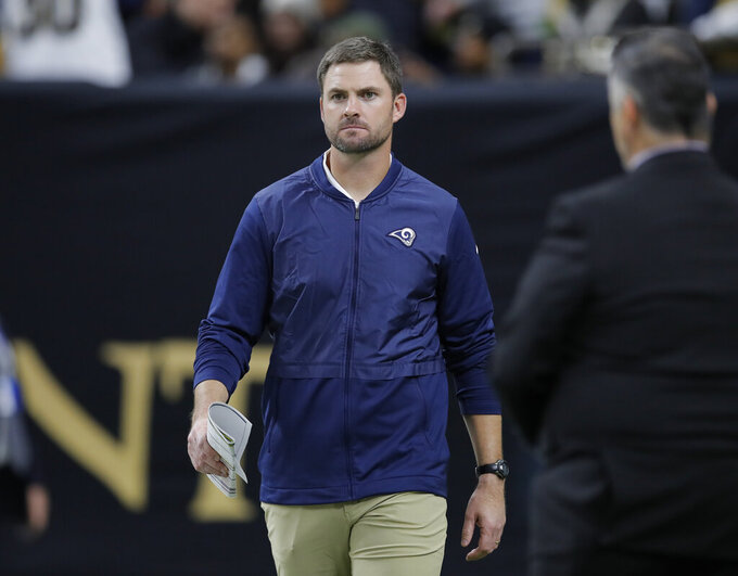 FILE - In this Jan. 20, 2019 file photo Los Angeles Rams quarterbacks coach Zac Taylor is seen before the NFL football NFC championship game against the New Orleans Saints in New Orleans. The Bengals have hired Taylor as their coach, Monday, Feb. 4, 2019, heading in different direction after failing to get a playoff win during Marvin Lewis' 16 seasons. They targeted the Rams quarterbacks coach as Lewis' replacement, but weren't able to close a deal until LA's season ended with a 13-3 loss to the Patriots in the Super Bowl on Sunday night. (AP Photo/Carolyn Kaster, file)