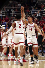 Stanford guard Bryce Wills (2) celebrates after a three-point basket with Spencer Jones (14) during the second half of an NCAA college basketball game against Colorado in Stanford, Calif., Sunday, March 1, 2020. (AP Photo/Jed Jacobsohn)