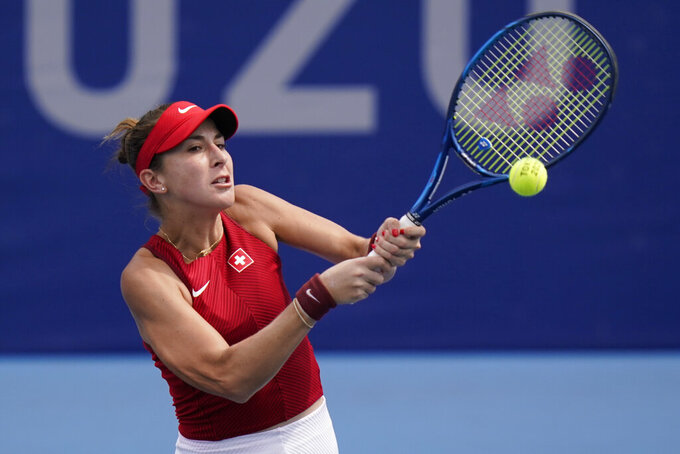 Belinda Bencic, of Switzerland, plays against Misaki Doi, of Japan, during the second round of the tennis competition at the 2020 Summer Olympics, Monday, July 26, 2021, in Tokyo, Japan. (AP Photo/Seth Wenig)