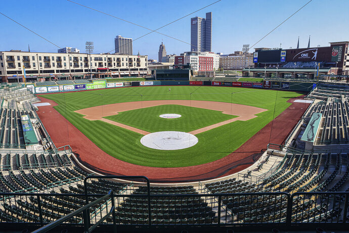 FILE - In this April 8, 2020, file photo, an empty Parkview Field minor league baseball stadium is viewed in downtown Fort Wayne, Ind. Minor league umpires are out of jobs so far and maybe all year with no minor league seasons due to the coronavirus pandemic. (Mike Moore/The Journal-Gazette via AP, File)