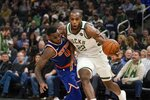 Milwaukee Bucks' Khris Middleton is fouled by New York Knicks' Kadeem Allen during the second half of an NBA basketball game Tuesday, Jan. 14, 2020, in Milwaukee. (AP Photo/Morry Gash)