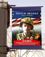 A picture of Loyd W. Brandt, Brandt served in the Us Marine Corps in the Pacific during WWII. (Adam Fondren/Rapid City Journal via AP)