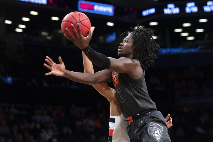 Oklahoma State forward Yor Anei (14) goes to the basket during the first half of an NCAA college semi final basketball game against the Syracuse in the NIT Season Tip-Off tournament, Wednesday, Nov. 27, 2019, in New York. (AP Photo/Mary Altaffer)