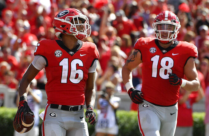 Georgia wide receiver Demetris Robertson (16)(16) celebrates his touchdown in the end zone against Austin Peay during the first half of an NCAA college football game, Saturday, Sept. 1, 2018, in Athens, Ga. (AP Photo/Mike Stewart)