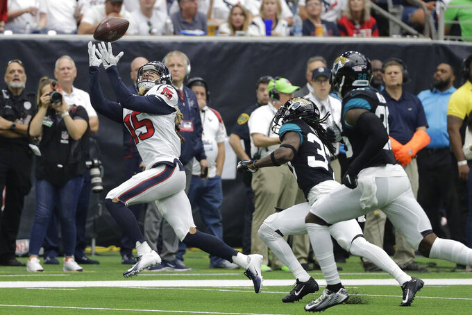 Houston Texans wide receiver Will Fuller (15) pulls in a pass against the Jacksonville Jaguars during the first half of an NFL football game Sunday, Sept. 15, 2019, in Houston. (AP Photo/David J. Phillip)