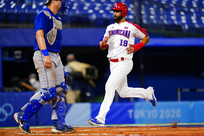 Dominican Republic's Jose Bautista score during a baseball game against Israel at the 2020 Summer Olympics, Tuesday, Aug. 3, 2021, in Yokohama, Japan. (AP Photo/Matt Slocum)