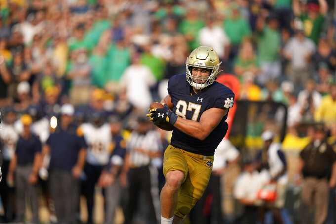 Notre Dame tight end Michael Mayer (87) makes a touchdown catch in the second half of an NCAA college football game against Toledo in South Bend, Ind., Saturday, Sept. 11, 2021. Notre Dame won 32-29. (AP Photo/AJ Mast)