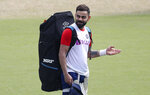 India's captain Virat Kohli gestures to a teammate after batting in the nets during a training session ahead of their first cricket test match against Bangladesh in Indore, India, Wednesday, Nov. 13, 2019. (AP Photo/Aijaz Rahi)
