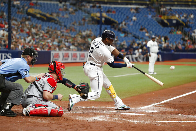 Tampa Bay Rays' Yandy Diaz (2) hits a three-run home run against the Minnesota Twins during the second inning of a baseball game on Saturday, Sept. 4, 2021, in St. Petersburg, Fla. (AP Photo/Scott Audette)