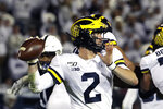 Michigan quarterback Shea Patterson throws a pass during the first half of the team's NCAA college football game against Penn State in State College, Pa., Saturday, Oct. 19, 2019. (AP Photo/Gene J. Puskar)