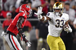 Notre Dame linebacker Shayne Simon (33) runs against Georgia defensive back Ameer Speed (9) during the second half of an NCAA college football game, Saturday, Sept. 21, 2019, in Athens, Ga. Georgia won 23-17. (AP Photo/Mike Stewart)
