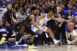 Miami guard Harlond Beverly (5) and Duke guard Cassius Stanley (2) chase the ball during the first half of an NCAA college basketball game in Durham, N.C., Tuesday, Jan. 21, 2020. (AP Photo/Gerry Broome)