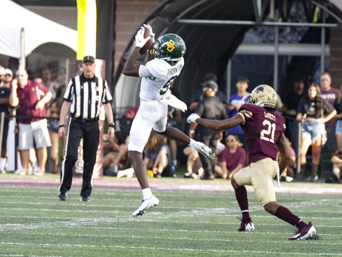 Baylor receiver Tyquan Thornton (9) catches a pass against Texas State defensive back Michael LoVett III during the first half of an NCAA college football game Saturday, Sept. 4, 2021, in San Marcos, Texas. (AP Photo/Michael Thomas)