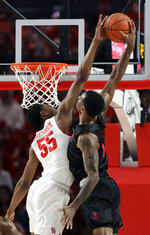 Southern Methodist's Isiaha Mike, right, is fouled by Houston's Brison Gresham (55) during the first half of an NCAA college basketball game Thursday, March 7, 2019, in Houston. (AP Photo/David J. Phillip)