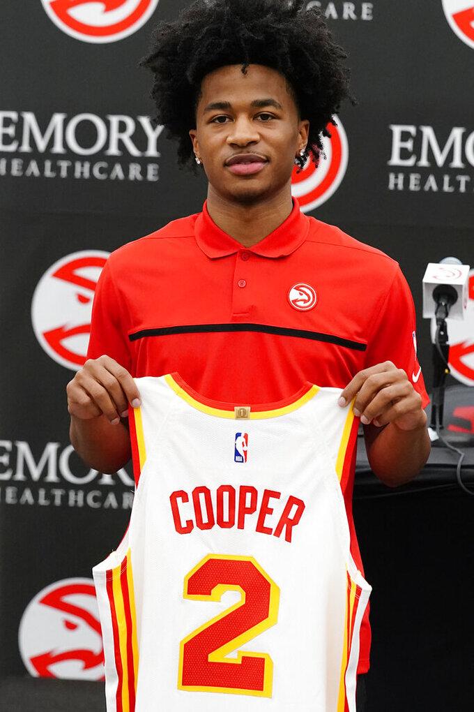 Atlanta Hawks NBA basketball draft pick Sharife Cooper poses for photos after a news conference Friday, July 30, 2021, in Atlanta. (AP Photo/John Bazemore)