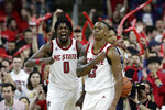 North Carolina State guard C.J. Bryce (13) and forward D.J. Funderburk (0) react following a play against Duke during the second half of an NCAA college basketball game in Raleigh, N.C., Wednesday, Feb. 19, 2020. (AP Photo/Gerry Broome)
