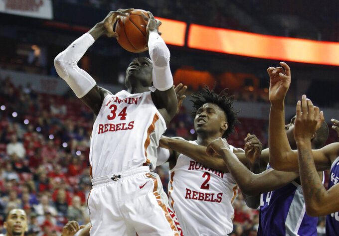 UNLV's Cheikh Mbacke Diong (34) grabs a rebound against Kansas State during the first half of an NCAA college basketball game Saturday, Nov. 9, 2019, in Las Vegas. (AP Photo/John Locher)