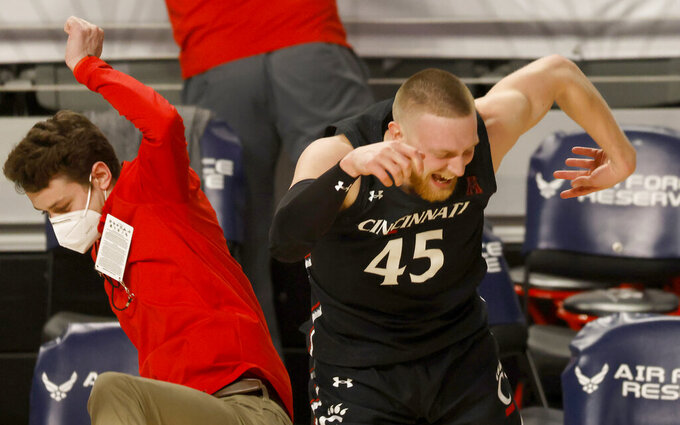 Cincinnati guard Mason Madsen (45) celebrates following Cincinnati's win over Wichita State after an NCAA college basketball game in the semifinal round of the American Athletic Conference men's tournament Saturday, March 13, 2021, in Fort Worth, Texas. (AP Photo/Ron Jenkins)