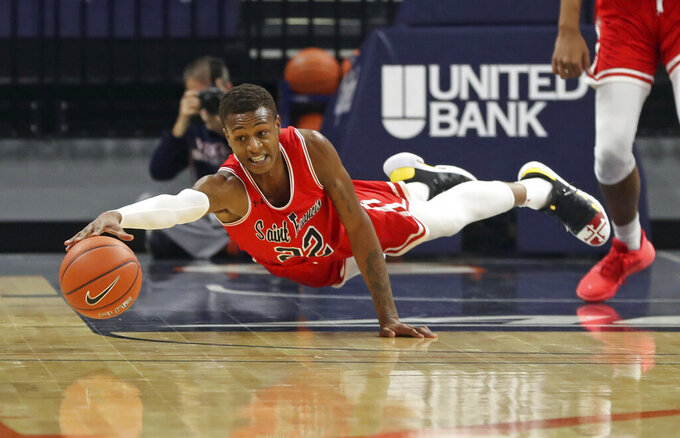 St. Francis guard Tyler Stewart (22) reaches for the loose ball during an NCAA college basketball game against Virginia, Tuesday, Dec. 1, 2020 in Charlottesville, Va. (Andrew Shurleff/The Daily Progress via AP)