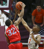 Myles Carter (32) of Delaware State and Landers Nolley II (2) of Virginia Tech battle for a rebound in the first half of an NCAA college basketball game in Blacksburg Va. Wednesday, Nov. 20 2019. (Matt Gentry/The Roanoke Times via AP)