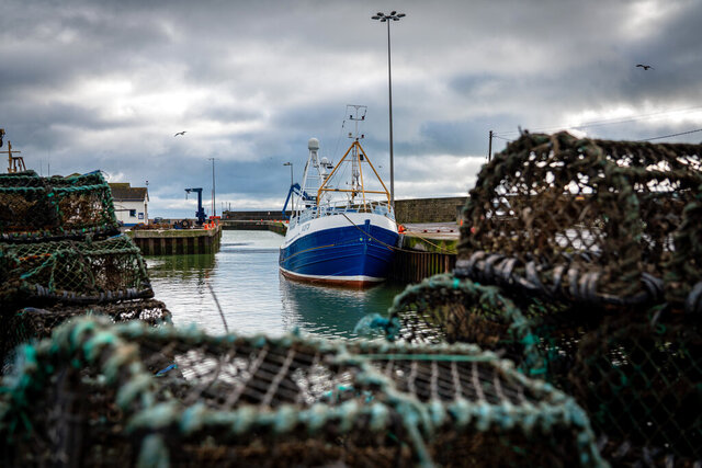 FILE- In this Tuesday, Jan. 28, 2020 file photo, a fishing vessel is docked at Kilkeel harbor in Northern Ireland. Fishing has become one of the main stumbling blocs in the Brexit negotiations for a new trade deal between the European Union and the United Kingdom. (AP Photo/David Keyton, File)