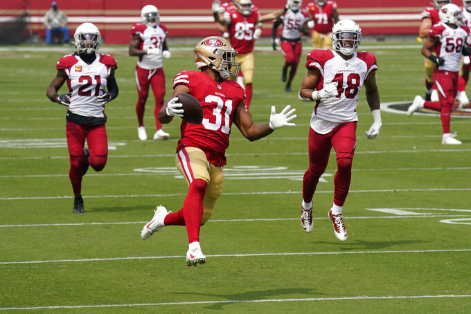 San Francisco 49ers running back Raheem Mostert (31) runs toward the end zone to score a touchdown against the Arizona Cardinals during the first half of an NFL football game in Santa Clara, Calif., Sunday, Sept. 13, 2020. (AP Photo/Tony Avelar)