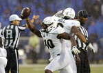 Central Florida defensive lineman Titus Davis (10) holds up the football after recovering a fumble against Memphis during the second half of an NCAA college football game Saturday, Oct. 13, 2018, in Memphis, Tenn. Central Florida won 31-30. (AP Photo/Mark Zaleski)