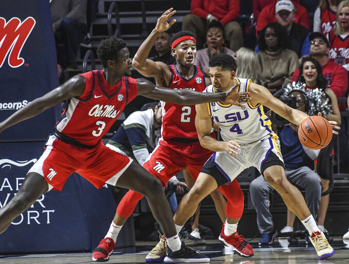 LSU guard Skylar Mays (4) is defended by Mississippi forward Khadim Sy (3) and guard Devontae Shuler (2) during an NCAA college basketball game in Oxford, Miss., Saturday, Jan. 18, 2020. (Bruce Newman/The Oxford Eagle via AP)