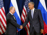 FILE - In this Sept. 28, 2015 file photo, President Barack Obama shakes hands with Russian President President Vladimir Putin before a bilateral meeting at United Nations headquarters.  (AP Photo/Andrew Harnik, File)