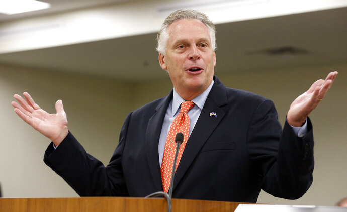FILE - In this Monday, Aug. 21, 2017, file photo, then-Virginia Gov. Terry McAuliffe delivers his annual budget projection at the Capitol in Richmond, Va. Former Virginia Gov. McAuliffe won't run for president in 2020, according to two people familiar with calls he made Wednesday, April 17, 2019, to allies. (AP Photo/Steve Helber, File)